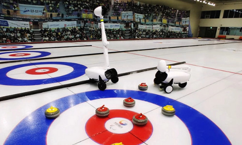 Curling robots on the ice.